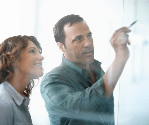 Increase Performance - Man showing increase performance to another person on whiteboard